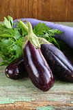 ripe purple eggplant on a wooden background