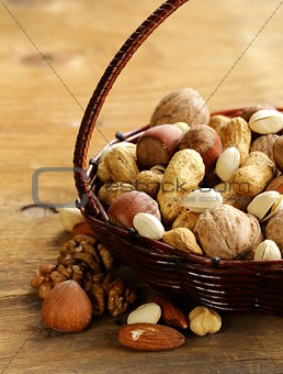 Assortment of different nuts (peanuts, hazelnuts, pistachios, walnuts)