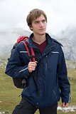 Portrait of young man hiking in the mountains