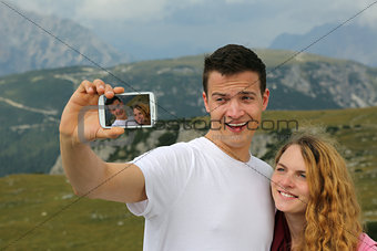 Taking pictures with a smartphone as holiday memory
