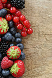 Fresh berries on a wooden board