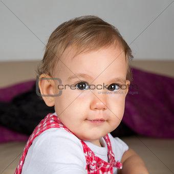 Baby looking into camera