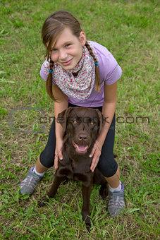 Little girl embracing her dog friend