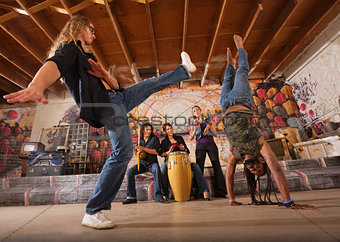 Capoeira Performers Kicking