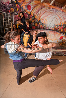 Capoeira Instructor Teaching Kicks