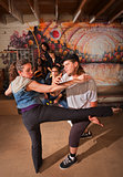 Capoeira Instructor Teaching a Woman