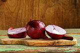 sweet red onions on a wooden chopping board