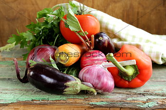 autumn harvest vegetables (eggplant, carrots, tomatoes, garlic)