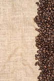 Coffee beans on hessian background