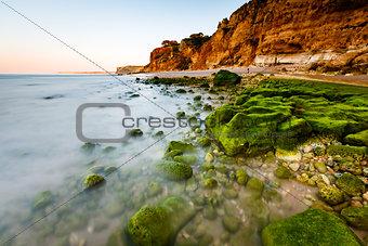Green Stones at Porto de Mos Beach in Lagos, Algarve, Portugal