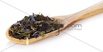 Fragrant dry tea leaves in wooden spoon