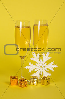 Christmas champagne in wine glasses small gift boxes