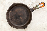 iron pan on a ceramic tile