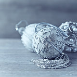 Silver christmas tree ornaments on wooden background