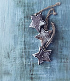 Rustic christmas stars on painted wood