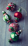 Colorful christmas ornaments on wooden background