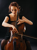 Beautiful female playing the cello