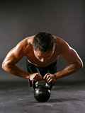 Pushups with kettlebell