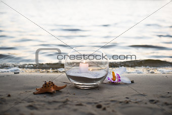 One candle at the sea, spa theme