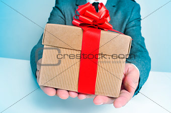 man in suit with a gift
