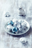 Christmas ornaments on a silver plate