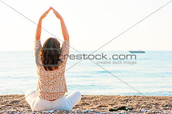 Pilates girl has sat on the beach