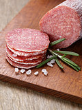 italian salami sausage slices with rosemary and sea salt