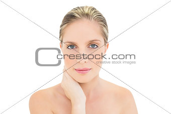 Thoughtful fresh blonde woman looking at camera
