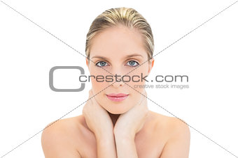 Thoughtful fresh blonde woman holding her neck