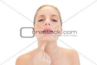 Calm fresh blonde woman touching her chin