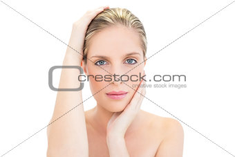 Relaxed fresh blonde woman holding her head