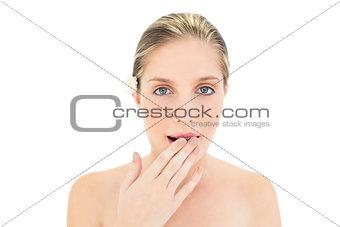 Tired fresh blonde woman yawning