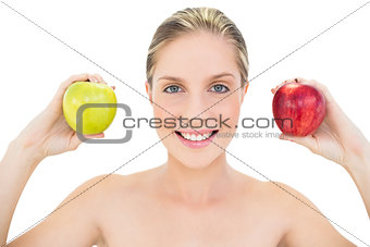 Pleased fresh blonde woman holding two apples