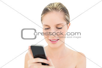 Focused fresh blonde woman using her mobile phone