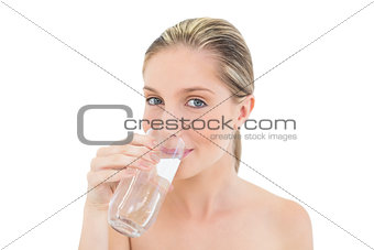 Lovely fresh blonde woman drinking water