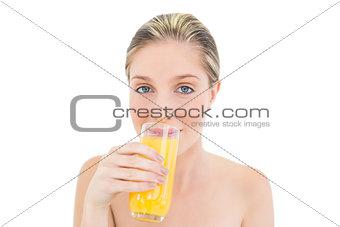 Natural fresh blonde woman drinking orange juice