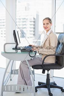 Smiling blonde businesswoman posing