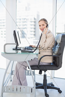 Smiling blonde businesswoman on the phone