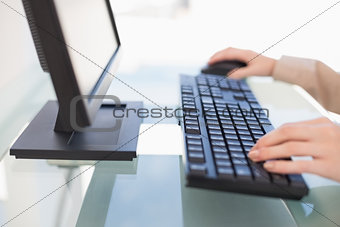 Close up on businesswoman typing on keyboard