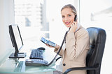Side view of smiling blonde businesswoman on the phone