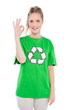 Happy blonde activist wearing recycling tshirt making okay gesture