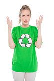 Annoyed blonde activist wearing recycling tshirt posing