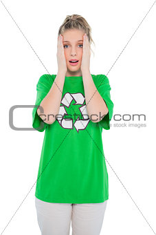 Anxious blonde activist wearing recycling tshirt posing