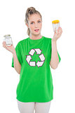 Peaceful environmental activist wearing recycling tshirt holding jars