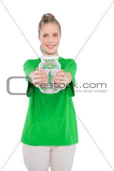 Smiling blonde activist holding glass jar