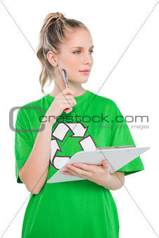 Thinking blonde activist holding clipboard