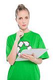 Pensive blonde activist holding clipboard