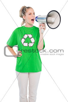 Energetic environmental activist shouting in megaphone