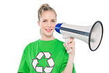 Cheerful environmental activist holding megaphone