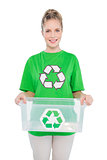Happy environmental activist holding recycling box